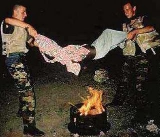 Belgian soldiers roasting a boy